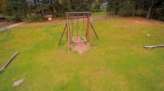 The wooden swing on the playground in Altja Stock Footage