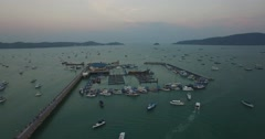 Aerial sunset flight over chalong pier Stock Footage