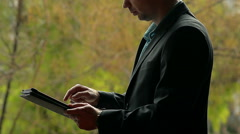 Сlose-Up of a Young Man in a Suit Using IPad Stock Footage