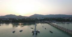 Beautiful sunset flight over Chalong pier big buddha Stock Footage