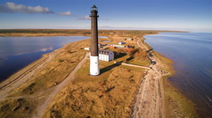 Stock Video Footage of The brown cylindrical lighthouse in Saaremaa