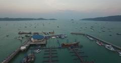 Aerial sunset flight over boat pier in phuket Stock Footage