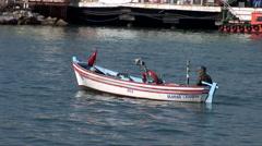 Turkish fisherman in small boat Stock Footage