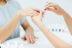 Getting nail manicure Stock Photos