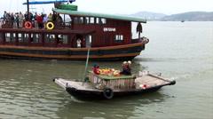 Vietnamese water people family selling fruit Stock Footage