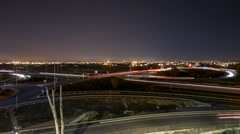 Time lapse busy light trail traffic, city skyline and stars Stock Footage