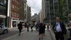 Young people walking on Fenchurch Street in London Stock Footage