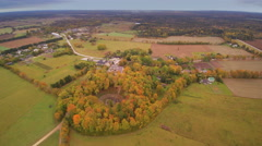 The aerial view of the greeny fields of Kaali Stock Footage