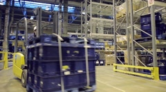 Loader operator working in warehouse Stock Footage