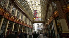 Leadenhall Market with flags and tourists in London - stock footage