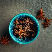 Authentic Blue Bowl Full of Anise Stars Stock Photos