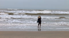 Fisherman on a stormy Golden beach in DaNang Stock Footage