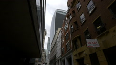 The tall 20 Fenchurch Street tower seen from Botolph Lane in London Stock Footage