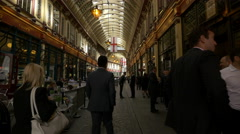 People walking in Leadenhall Market in London - stock footage