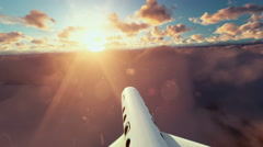 Cesna aircraft passing, above clouds at sunset Stock Footage