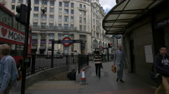 King William Street with people, cars and underground station in London Stock Footage