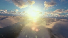 Cesna airplane flying above clouds at sunset Stock Footage