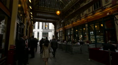 Men and women walking in Leadenhall Market in London - stock footage