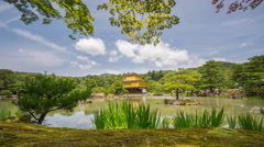 Wide view of amazing Golden Pavilion temple time lapse Stock Footage