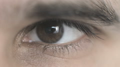 Stock Video Footage of Macro footage of an blinking, human, male eye. Shallow DOF