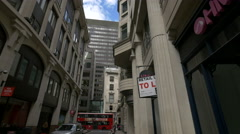 Leadenhall Street's buildings seen from Whittington Ave in London - stock footage