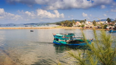 Fishing Boats Drift to-and-fro in Bay Resort City Hills Sky Stock Footage