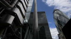 Lloyd's of London and The Gerkin seen from Lime Street in London Stock Footage