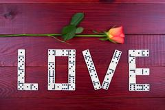 Word love with dominoes - stock photo