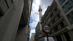 The Monument to the Great Fire of London seen from Fish Street Hill Stock Footage