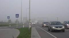 freeway cars traffic in heavy fog smog. 4K - stock footage