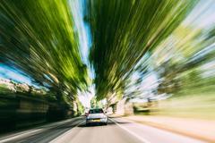 Speeding Car On A Highway, Country Asphalt Road. Motion Blur Bac - stock photo