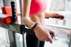 Woman athlete with fitness tracker on hand working out Stock Photos