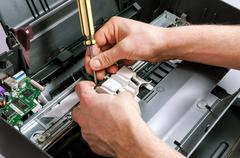 Maintenance and repair of the printer Stock Photos