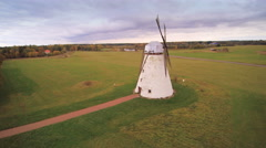 The old windmill on the side of the road Stock Footage