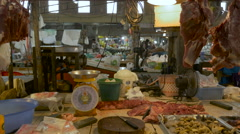 Dolly shot of a market in Thailand with raw meat sitting out in the open Stock Footage