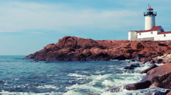 Lighthouse on rocky New England coast Stock Footage