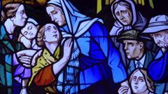 Poor people depicted on stained glass window, panting. Population war's victims. Stock Footage