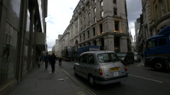 Driving and riding bikes on King William Street in London Stock Footage
