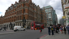 Driving and walking on Liverpool Street in London Stock Footage