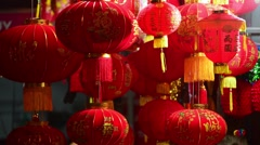 Lucky charm items in red and gold are for sale before lunar new year - stock footage
