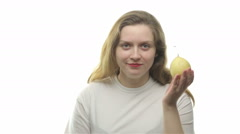 Fatty woman eating pear - stock footage