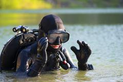 diver woman in the water - stock photo