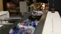 Unpopulated printed circuit board on assembly line Stock Footage