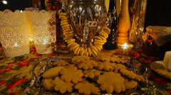 Still life with pretzels, biscuits, lanterns and a big samovar Stock Footage