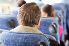 Close up of senior man sitting in travel bus Stock Photos