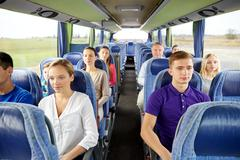 group of passengers or tourists in travel bus - stock photo