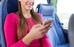 Close up of woman in travel bus with smartphone Stock Photos