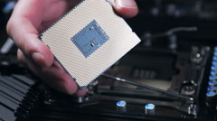 Stock Video Footage of cpu in hand and motherboard for a home computer