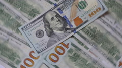 Cash Money Background Close-Up Rotation. 100 Us Dollars On The Top Of The Head Stock Footage