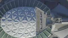Aerial shot Olympic Stadium camera looking down during sunrise Stock Footage